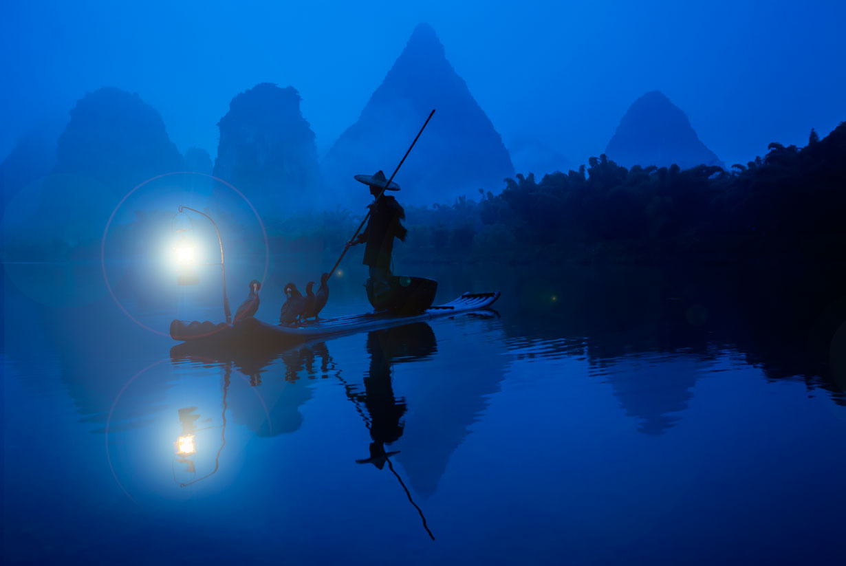 Pescador con cormoranes en Guilin.